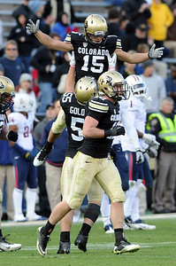 Jason Espinoza (15) is picked up by David Goldberg after his interception late in the game against Arizona. For more photos of the Buffs, go to www.dailycamera.com Cliff Grassmick / November 12, 2011