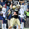 "Jason Espinoza (15) is picked up by David Goldberg after his interception late in the game against Arizona.<br /> For more photos of the Buffs, go to  <a href=""http://www.dailycamera.com"">http://www.dailycamera.com</a><br /> Cliff Grassmick / November 12, 2011"