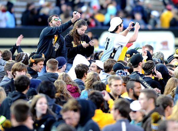 "University of Colorado football fans come on to the field after the Buffaloes win over Arizona on Saturday.<br /> For more photos of the Buffs, go to  <a href=""http://www.dailycamera.com"">http://www.dailycamera.com</a><br /> Cliff Grassmick / November 12, 2011"