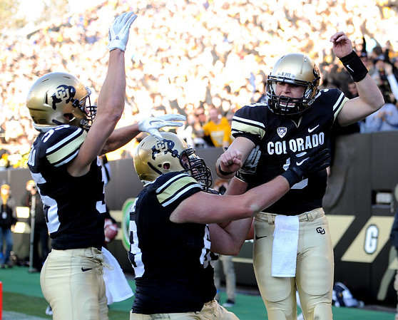 "Tyler Hansen, right, is excited about his touchdown catch against Arizona on Saturday.<br /> For more photos of the Buffs, go to  <a href=""http://www.dailycamera.com"">http://www.dailycamera.com</a><br /> Cliff Grassmick / November 12, 2011"