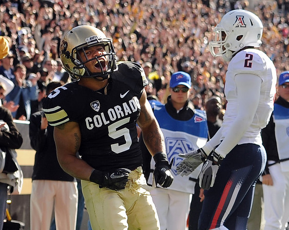 "Rodney Stewart of CU celebrates his first touchdown against Arizona on Saturday.<br /> For more photos of the Buffs, go to  <a href=""http://www.dailycamera.com"">http://www.dailycamera.com</a><br /> Cliff Grassmick / November 12, 2011"