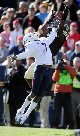 "Toney Clemons makes a difficult catch over Cortez Johnson of Arizona.<br /> For more photos of the Buffs, go to  <a href=""http://www.dailycamera.com"">http://www.dailycamera.com</a><br /> Cliff Grassmick / November 12, 2011"