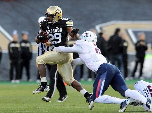 "Josh Ford of CU runs through the Arizona defense.<br /> For more photos of the Buffs, go to  <a href=""http://www.dailycamera.com"">http://www.dailycamera.com</a><br /> Cliff Grassmick / November 12, 2011"
