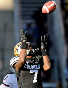 University of Colorado's Toney Clemons makes a big catch during a game against the University of Arizona on Saturday, Nov. 12, at Folsom Field on the CU campus in Boulder. CU won the game 48-29. For more photos of the game go to www.dailycamera.com Jeremy Papasso/ Camera