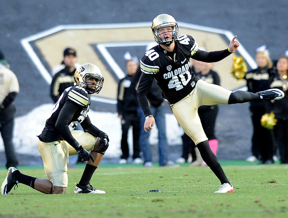 "University of Colorado's Justin Castor kicks off after a fourth quarter touchdown during a game against the University of Arizona on Saturday, Nov. 12, at Folsom Field on the CU campus in Boulder. CU won the game 48-29. For more photos of the game go to  <a href=""http://www.dailycamera.com"">http://www.dailycamera.com</a><br /> Jeremy Papasso/ Camera"