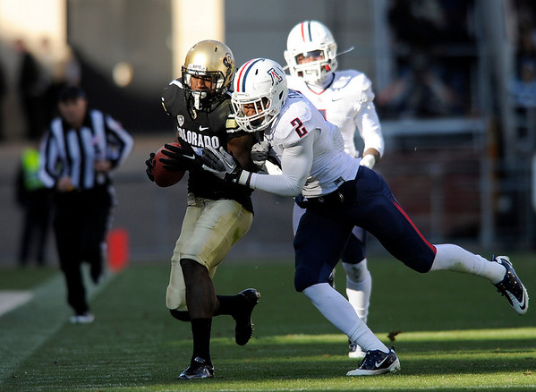 "University of Colorado's Toney Clemons is pushed out of bounds by Arizona's Marquis Flowers after making a catch during a game against the University of Arizona on Saturday, Nov. 12, at Folsom Field on the CU campus in Boulder. CU won the game 48-29. For more photos of the game go to  <a href=""http://www.dailycamera.com"">http://www.dailycamera.com</a><br /> Jeremy Papasso/ Camera"