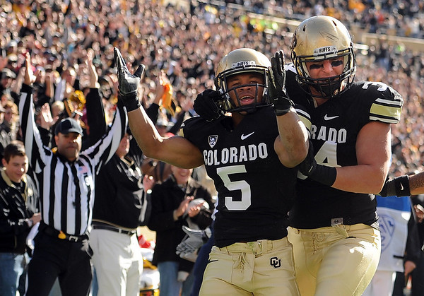 "Rodney Stewart of CU celebrates his first touchdown with Ryan Deehan against Arizona on Saturday.<br /> For more photos of the Buffs, go to  <a href=""http://www.dailycamera.com"">http://www.dailycamera.com</a><br /> Cliff Grassmick / November 12, 2011"