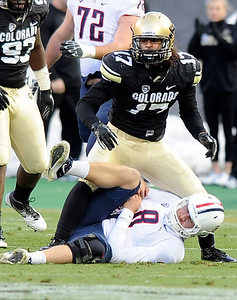 University of Colorado's Josh Hartigan stands above Arizona quarterback Nick Foles after sacking him during a game against the University of Arizona on Saturday, Nov. 12, at Folsom Field on the CU campus in Boulder. CU won the game 48-29. For more photos of the game go to www.dailycamera.com Jeremy Papasso/ Camera