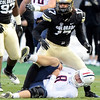 "University of Colorado's Josh Hartigan stands above Arizona quarterback Nick Foles after sacking him during a game against the University of Arizona on Saturday, Nov. 12, at Folsom Field on the CU campus in Boulder. CU won the game 48-29. For more photos of the game go to  <a href=""http://www.dailycamera.com"">http://www.dailycamera.com</a><br /> Jeremy Papasso/ Camera"