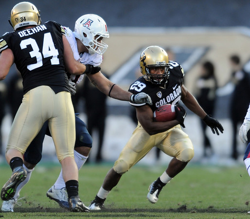 """Josh Ford of CU runs around the Arizona defense.<br /> For more photos of the Buffs, go to  <a href=""""http://www.dailycamera.com"""">http://www.dailycamera.com</a><br /> Cliff Grassmick / November 12, 2011"""