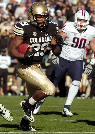 "University of Colorado's Josh Ford rushes the ball during a game against the University of Arizona on Saturday, Nov. 12, at Folsom Field on the CU campus in Boulder. CU won the game 48-29. For more photos of the game go to  <a href=""http://www.dailycamera.com"">http://www.dailycamera.com</a><br /> Jeremy Papasso/ Camera"