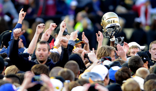 """The CU fans salute the Buffs on Saturday.<br /> For more photos of the Buffs, go to  <a href=""""http://www.dailycamera.com"""">http://www.dailycamera.com</a><br /> Cliff Grassmick / November 12, 2011"""