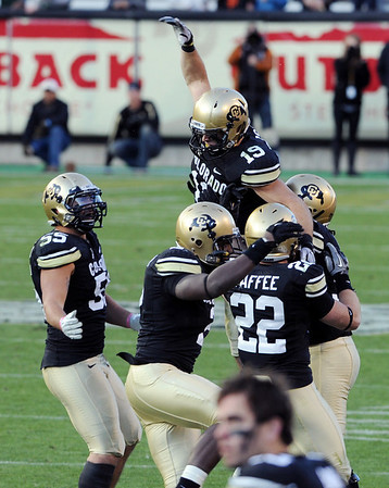 "Travis Sandersfeld, top,  of CU, celebrates with his defensive teammates late in the win over Arizona.<br /> For more photos of the Buffs, go to  <a href=""http://www.dailycamera.com"">http://www.dailycamera.com</a><br /> Cliff Grassmick / November 12, 2011"