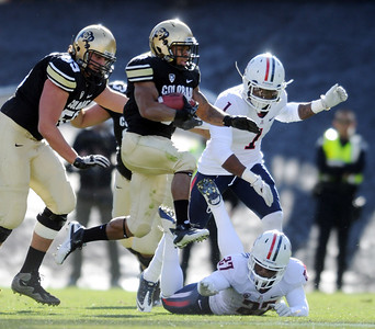 Rodney Stewart of CU  uses his hops to run over the Arizona Wildcats. For more photos of the Buffs, go to www.dailycamera.com Cliff Grassmick / November 12, 2011