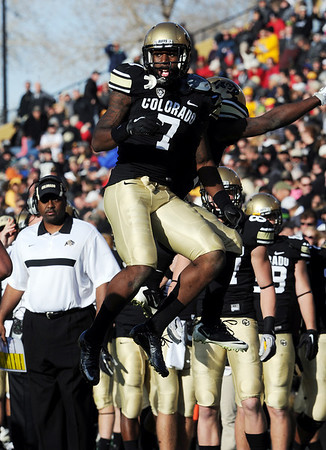 """Toney Clemons celebrates his TD catch with Ray Polk on the sidelines.<br /> For more photos of the Buffs, go to  <a href=""""http://www.dailycamera.com"""">http://www.dailycamera.com</a><br /> Cliff Grassmick / November 12, 2011"""