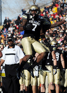 Toney Clemons celebrates his TD catch with Ray Polk on the sidelines. For more photos of the Buffs, go to www.dailycamera.com Cliff Grassmick / November 12, 2011