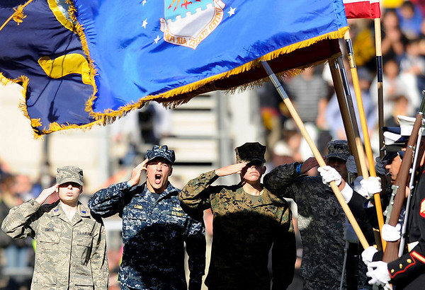 """University of Colorado's ROTC cadets salute the flags before the start of the game against the University of Arizona on Saturday, Nov. 12, at Folsom Field on the CU campus in Boulder. CU won the game 48-29. For more photos of the game go to  <a href=""""http://www.dailycamera.com"""">http://www.dailycamera.com</a><br /> Jeremy Papasso/ Camera"""