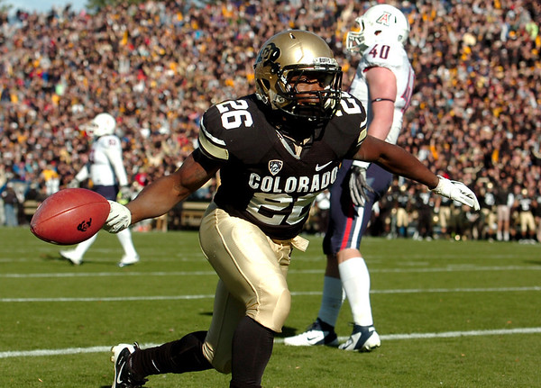 "University of Colorado's Tony Jones celebrates in the end zone after scoring a touchdown during a game against the University of Arizona on Saturday, Nov. 12, at Folsom Field on the CU campus in Boulder. For more photos of the game go to  <a href=""http://www.dailycamera.com"">http://www.dailycamera.com</a><br /> Jeremy Papasso/ Camera"