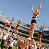 University of Colorado freshman Rosie Philpott, front right, does a cheer with the rest of the CU cheerleaders before the game against Colorado State University on Saturday, Sept. 4, at Invesco Field in Denver.<br /> Photo by JEREMY PAPASSO