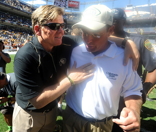 "Coach Dan Hawkins and  Steve Fairchild  of CSU meet after the CU 24-3 win.<br /> For more  photos of the game, go to  <a href=""http://www.dailycamera.com"">http://www.dailycamera.com</a><br /> Cliff Grassmick / September 4, 2010"