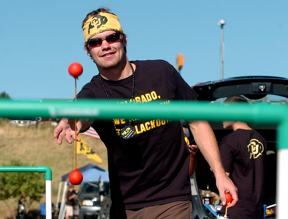 "Ryan Kane, a CU student and football fan, plays a one of the tailgating games outside Invesco Field.<br /> For more photos of the game,  <a href=""http://www.dailycamera.com"">http://www.dailycamera.com</a>.<br /> Cliff Grassmick / September 4, 2010"