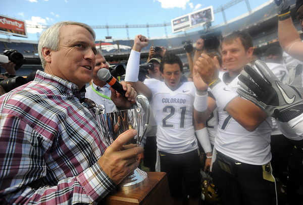 "Gov. Bill Ritter presents the Centennial Trophy to the CU Buffs after the game.<br /> For more  photos of the game, go to  <a href=""http://www.dailycamera.com"">http://www.dailycamera.com</a><br /> Cliff Grassmick / September 4, 2010"
