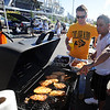 """Dan Cashmore, left, and Dan Estrada, cook food for his crew during CU tailgating.<br /> For more photos of the game, go to  <a href=""""http://www.dailycamera.com"""">http://www.dailycamera.com</a>.<br /> Cliff Grassmick / September 4, 2010"""
