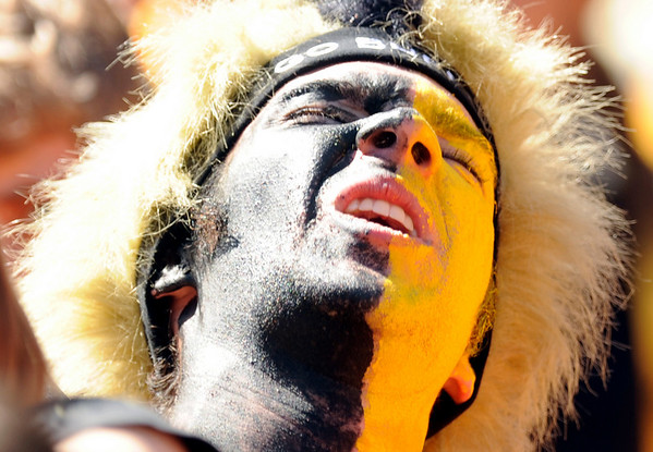 University of Colorado senior Russell Pikus warms up his vocal chords before the football game against Colorado State University on Saturday, Sept. 4, at Invesco Field in Denver.<br /> Photo by JEREMY PAPASSO