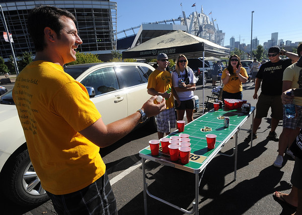 "Craig Franzoi, left, plays a ball  beer game with his CU Buff friends before the game.<br />  For more photos of the game, go to  <a href=""http://www.dailycamera.com"">http://www.dailycamera.com</a>.<br /> Cliff Grassmick / September 4, 2010"