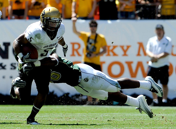 Colorado's Rodney Stewart (left) is tackled by Colorado State's Ricky Brewer after a 6 yard gain during their football game  in Denver, Colorado September 4, 2010.  CAMERA/Mark Leffingwell