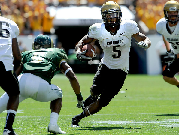 Colorado's Rodney Stewart (right) slips past Colorado State's Momo Thomas (left) during their football game  in Denver, Colorado September 4, 2010.  CAMERA/Mark Leffingwell