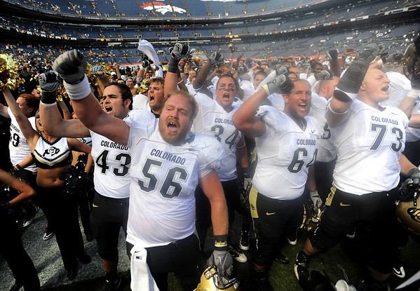 "Keenan Stevens (56), Mike Iltis (64) and Ryan Miller lead the Buffs in the CU fight song after the win.<br /> For more  photos of the game, go to  <a href=""http://www.dailycamera.com"">http://www.dailycamera.com</a><br /> Cliff Grassmick / September 4, 2010"