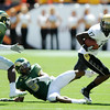 """Toney Clemons of CU spins out of trouble.<br /> For more  photos of the game, go to  <a href=""""http://www.dailycamera.com"""">http://www.dailycamera.com</a><br /> Cliff Grassmick / September 4, 2010"""