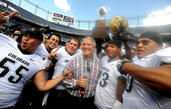 "Gov. Bill Ridder, a CU alum, poses with the Buffs after the win.<br /> For more  photos of the game, go to  <a href=""http://www.dailycamera.com"">http://www.dailycamera.com</a><br /> Cliff Grassmick / September 4, 2010"