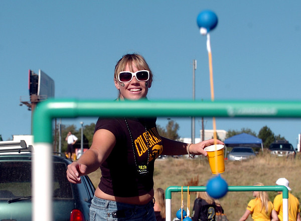 "Astrid Vander, a CU student and football fan, plays a one of the tailgating games outside Invesco Field.<br /> For more photos of the game, go to  <a href=""http://www.dailycamera.com"">http://www.dailycamera.com</a>.<br /> Cliff Grassmick / September 4, 2010"