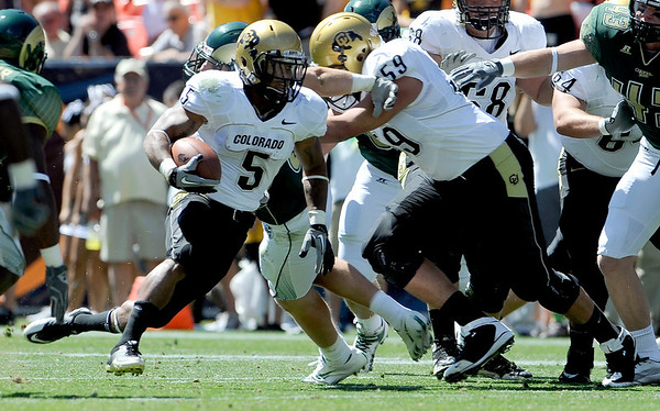 Colorado's Rodney Stewart (left) breaks in to open field on a block from David Bakhtiari (right) against Colorado State during their football game  in Denver, Colorado September 4, 2010.  CAMERA/Mark Leffingwell