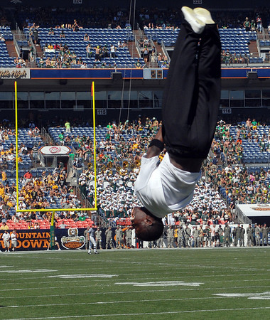 """Ozell Williams of the CU cheer team flips through the endzone on Saturday.<br /> For more  photos of the game, go to  <a href=""""http://www.dailycamera.com"""">http://www.dailycamera.com</a><br /> Cliff Grassmick / September 4, 2010"""