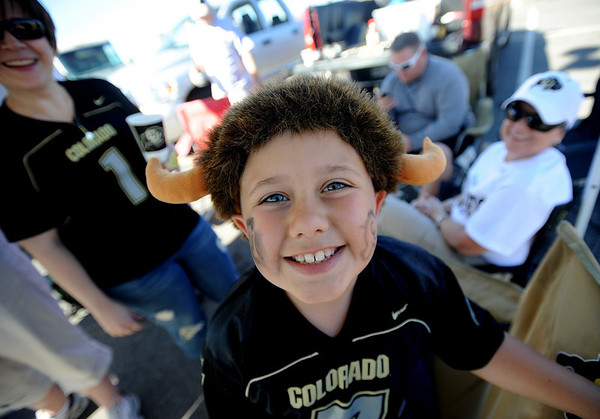 "CU fan, Logan Schecter, 8, of Colorado Springs, hangs out  with his family before the game.<br /> For more photos, go to  <a href=""http://www.dailycamera.com"">http://www.dailycamera.com</a>.<br /> Cliff Grassmick / September 4, 2010"