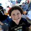 """CU fan, Logan Schecter, 8, of Colorado Springs, hangs out  with his family before the game.<br /> For more photos, go to  <a href=""""http://www.dailycamera.com"""">http://www.dailycamera.com</a>.<br /> Cliff Grassmick / September 4, 2010"""