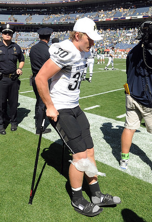 """Parker Orms of CU was injured during the CSU game.<br /> For more  photos of the game, go to  <a href=""""http://www.dailycamera.com"""">http://www.dailycamera.com</a><br /> Cliff Grassmick / September 4, 2010"""