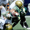 Colorado's Anthony Perkins (top) and Jon Major (bottom) tackle Colorado State's T.J. Borcky (middle) at the line of scrimmage during their football game  in Denver, Colorado September 4, 2010.  CAMERA/Mark Leffingwell