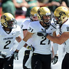 """Scotty McKnight (21) of CU, celebrates his TD and CU record with teammates against CSU.<br /> For more  photos of the game, go to  <a href=""""http://www.dailycamera.com"""">http://www.dailycamera.com</a><br /> Cliff Grassmick / September 4, 2010"""