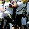 Colorado's David Bakhtiari (left) and Ryan Miller hold up Travon Patterson after Patterson's touchdown against Colorado State during their football game  in Denver, Colorado September 4, 2010.  CAMERA/Mark Leffingwell