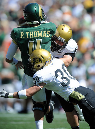 """Curtis Cunningham and Parker Orms of CU pressure Pete Thomas of CSU.<br /> For more photos of the game, go to  <a href=""""http://www.dailycamera.com"""">http://www.dailycamera.com</a><br /> Cliff Grassmick / September 4, 2010"""