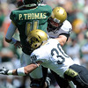"Curtis Cunningham and Parker Orms of CU pressure Pete Thomas of CSU.<br /> For more photos of the game, go to  <a href=""http://www.dailycamera.com"">http://www.dailycamera.com</a><br /> Cliff Grassmick / September 4, 2010"