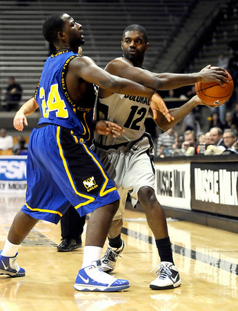 Coppin State's Karrem Brown (left) guards Colorado's Dwight Thorne (right) during their basketball game at the University of Colorado in Boulder, Colorado November 16, 2009. CAMERA/Mark Leffingwell
