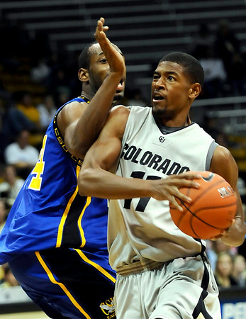 Colorado's Cory Higgins (right) drives past Coppin State's Branden Doughty (left) during their basketball game at the University of Colorado in Boulder, Colorado November 16, 2009. CAMERA/Mark Leffingwell