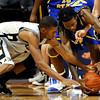Colorado's Cory Higgins (left) steals the ball from Coppin State's Sam Coleman (right) during their basketball game at the University of Colorado in Boulder, Colorado November 16, 2009. CAMERA/Mark Leffingwell