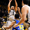 Colorado's Marcus Relphorde (left) takes a 3-point shot over Coppin State's Jonathan Landry (right) during their basketball game at the University of Colorado in Boulder, Colorado November 16, 2009. CAMERA/Mark Leffingwell