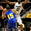 Colorado's Dwight Thorne (right) pressures Coppin State's George Jackson (left) during their basketball game at the University of Colorado in Boulder, Colorado November 16, 2009. CAMERA/Mark Leffingwell